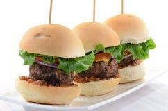 Hamburger sliders. Seasoned grilled hamburger sliders on white background Royalty Free Stock Photography