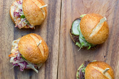 Hamburger Sliders. With Shrimp on a rustic cutting wooden board Stock Image