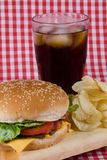 Hamburger and soda. Tasty hamburger with soda and chips Stock Image