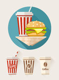 Hamburger and soda in paper cups Stock Photos