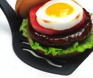 Hamburger on spatula Royalty Free Stock Photography