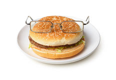 Hamburger in spectacles Royalty Free Stock Photos