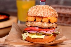 Hamburger stabbed with a knife Royalty Free Stock Image