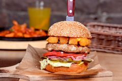 Hamburger stabbed with a knife Stock Images