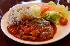 Hamburger steak. And salad on a plate Stock Image