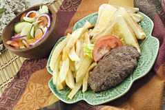 Hamburger Steak with Home Fries and Salad Stock Image