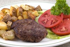 Hamburger Steak Platter with Fried Potatoes Stock Image