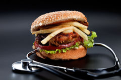 Hamburger with stethoscope Royalty Free Stock Photo