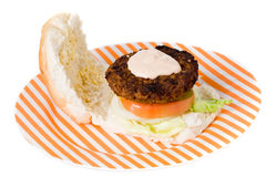 Hamburger on a stiped plate. On a white backround Royalty Free Stock Photography