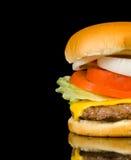 Hamburger sul nero Fotografia Stock