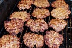 Hamburger sulla griglia Immagine Stock