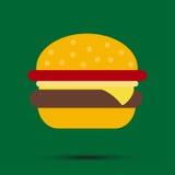 Hamburger sur un fond vert avec l'ombre Photo stock