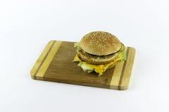 Hamburger sur une table de hachage Photographie stock