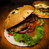 Hamburger. Tasty burger on the table Stock Photos
