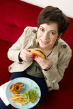 Business WOman Enjoys Hamburger at Lunch Time Stock Image