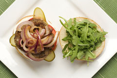 Hamburger topped with onions Stock Photo