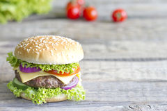 Hamburger on vintage wooden board Stock Photo