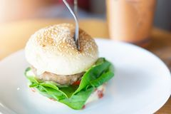 Hamburger in a white ceramic dish at restaurant stock photo