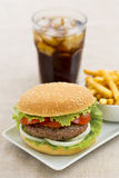 Hamburger wiht french fries and fresh drink. A sandwich with meat and salad served with fries  and iced soda Stock Photo