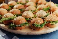 Hamburger on wood table. Home made burger. Fastfood meal. Pub burger. Delicious Hamburger. Gourmet hamburger. r Stock Photo