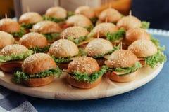 Hamburger on wood table. Home made burger. Fastfood meal. Pub burger. Delicious Hamburger. Gourmet hamburger. r Stock Photos