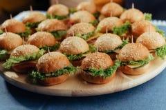 Hamburger on wood table. Home made burger. Fastfood meal. Pub burger. Delicious Hamburger. Gourmet hamburger. r Royalty Free Stock Images