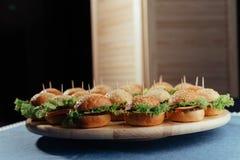 Hamburger on wood table. Home made burger. Fastfood meal. Pub burger. Delicious Hamburger. Gourmet hamburger. r Stock Image