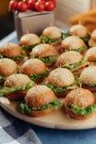Hamburger on wood table. Home made burger. Fastfood meal. Pub burger. Delicious Hamburger. Gourmet hamburger. r Royalty Free Stock Photo