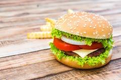 Hamburger on wood table Royalty Free Stock Image