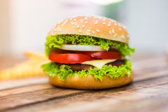 Hamburger on wood table Stock Image