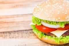 Hamburger on wood table ,sun flare filter Stock Photography