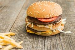 Hamburger. On wooden background. Fast food addiction stock image