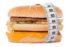 Hamburger wrapped around a measurement tape Stock Image