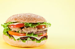 Hamburger on yellow Royalty Free Stock Photos
