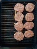 Hamburgerburger-Treffenscheiben lizenzfreie stockfotografie