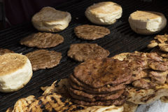 Hamburgers on barbeque Royalty Free Stock Photo