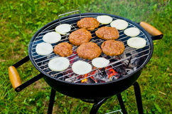 Hamburgers on the BBQ. Hamburgers baked on the BBQ Royalty Free Stock Photos