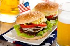 Hamburgers and beer. Royalty Free Stock Photo