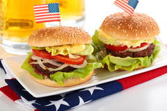 Hamburgers and beer. Stock Image