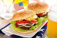 Hamburgers and beer. Royalty Free Stock Photos