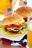 Hamburgers and beer. Royalty Free Stock Image