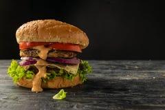 Hamburgers blancs et noirs photo stock