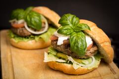 Hamburgers with cheese and basil Stock Photo