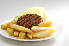 Hamburgers and chips Stock Images