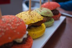 Four colorful and mini hamburgers royalty free stock photo