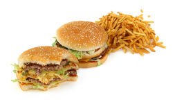Hamburgers and french fries Stock Images