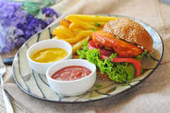 Hamburgers and French fries. On the table royalty free stock images