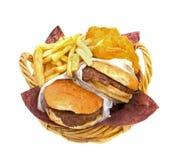 Hamburgers Fries and Potato Cakes. Basket filled with hamburgers, fries and potato cakes on white background Stock Photos