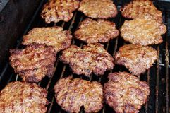 Hamburgers on the Grill Stock Image