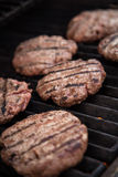 Hamburgers on the grill Royalty Free Stock Photography